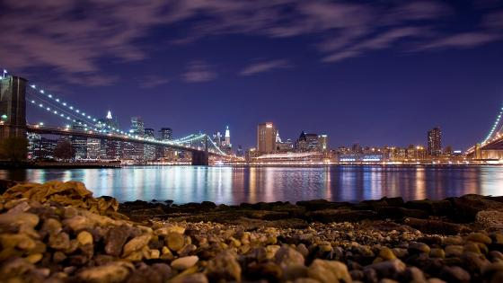 Lower Manhattan and Brooklyn Bridge at night wallpaper