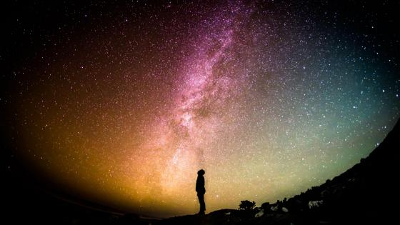 Man under the milky way wallpaper