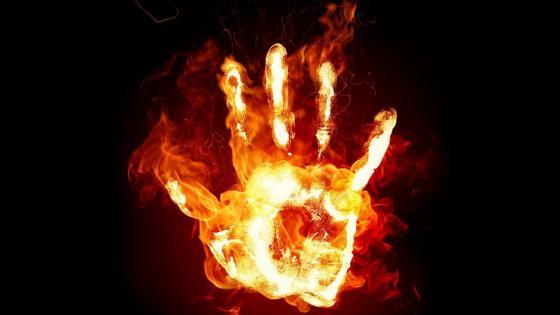 Hand on fire wallpaper