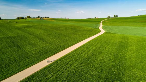 Long road in the green hills wallpaper