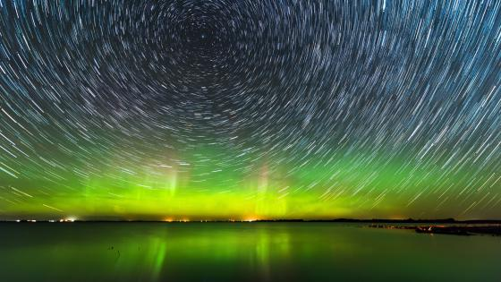 Star trails and Aurora Borealis wallpaper
