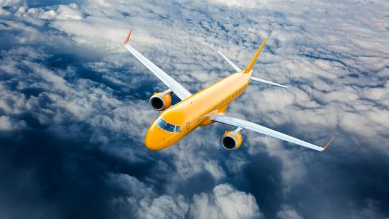Yellow airbus above the clouds wallpaper