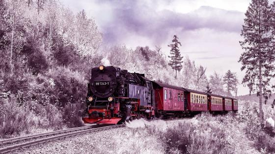 Steam train in winter landscape wallpaper