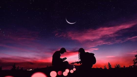 Playing guitar under the crescent moon wallpaper