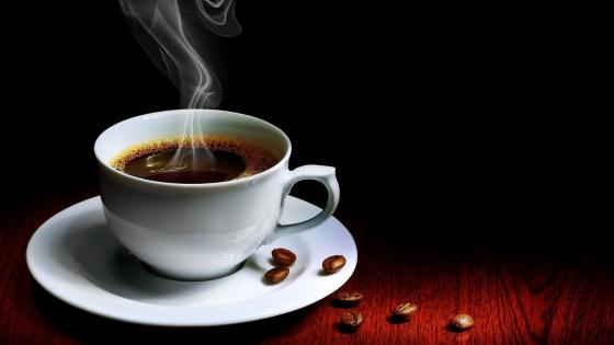 Hot steaming cup of coffee wallpaper