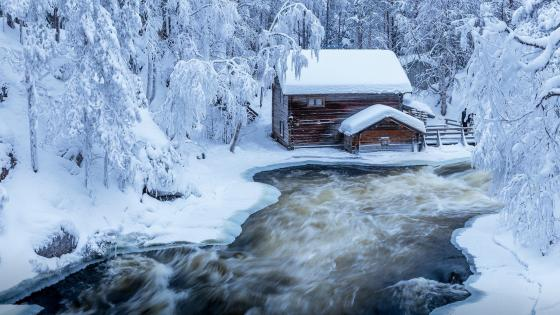 Snowy Log cabin at Kitkajoki river in Finland wallpaper