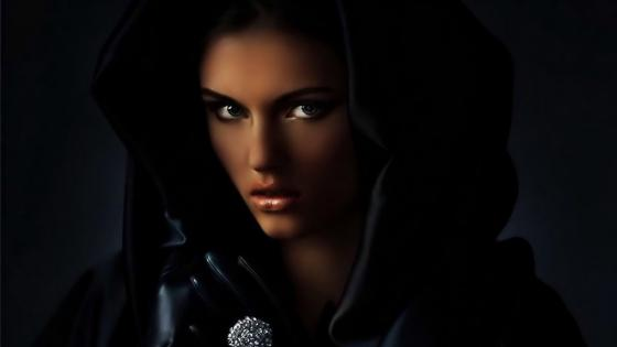 Girl in hooded black cloak wallpaper