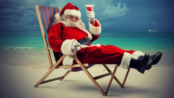 Santa Claus on the beach wallpaper