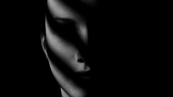 Humanoid face in the shadow wallpaper