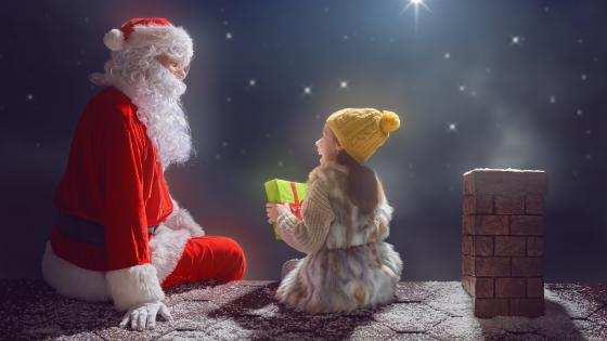 Santa Claus on the rooftop wallpaper