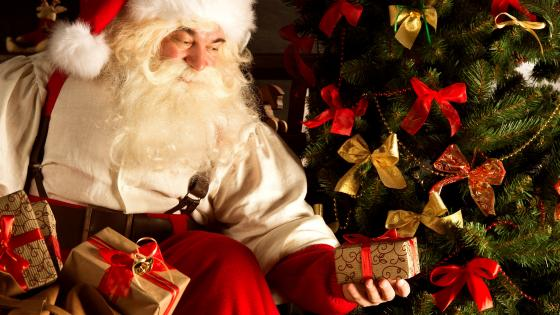 Santa Claus with christmas gifts wallpaper