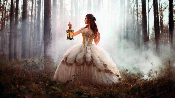Girl in vintage dress at the forest with lantern wallpaper