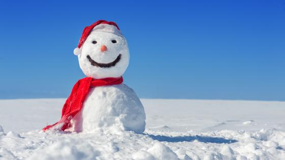 Smiling snowman dressed as a Santa Claus wallpaper