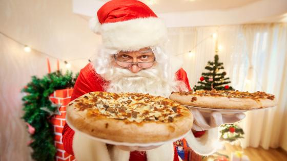 Santa with pizzas wallpaper
