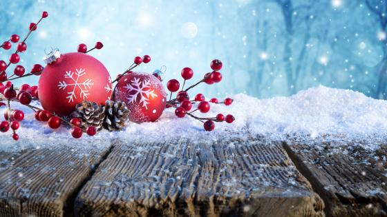 Red Christmas balls in the snow wallpaper