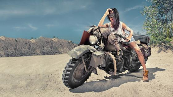 Sexy biker woman on the desert wallpaper