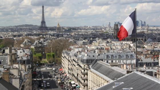Paris Cityscape Behind the Flag of France wallpaper
