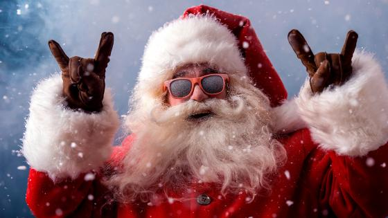 Santa Claus in sunglasses and devil horns hands sign wallpaper