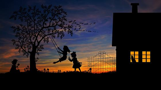 Swinging little girls silhouette wallpaper