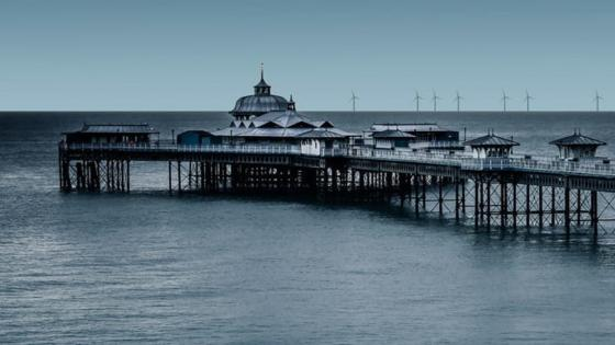Llandudno Pier and windmills in the distance wallpaper