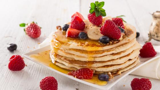 American pancakes with maple syrup and berrries wallpaper