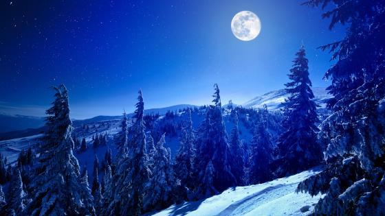 Full moon above the snowy mountains wallpaper