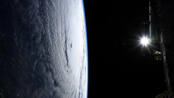 Space Station Flight Over Hurricane Lane wallpaper