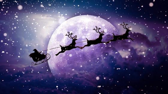 Santa Claus chariot in the moonlight wallpaper