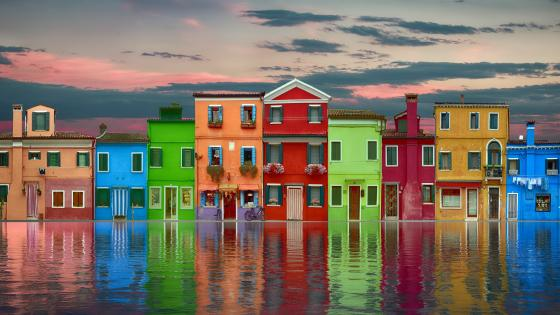 Colorful houses reflecting in a canal wallpaper