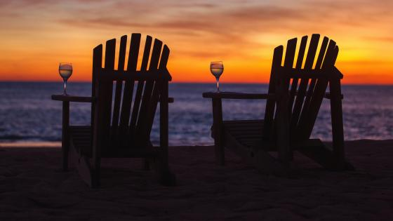 Chairs on the beach at sunset wallpaper