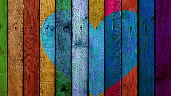 Heart on wood planks wallpaper