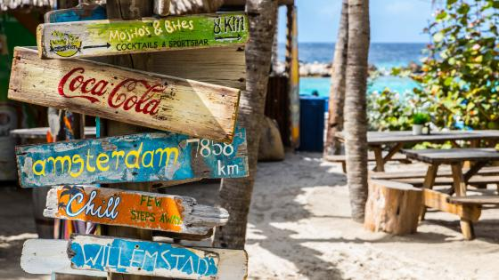 Wooden Sign on Mambo Beach wallpaper