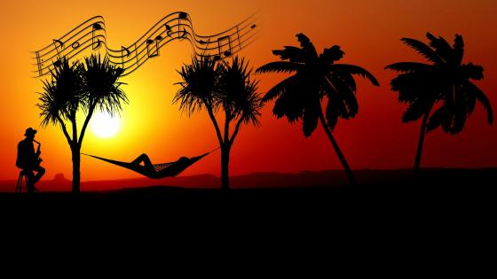 Saxophonist in the sunset wallpaper
