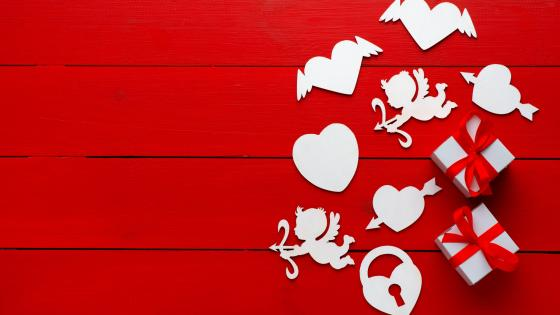 Valentine's day decoration on red wood planks wallpaper