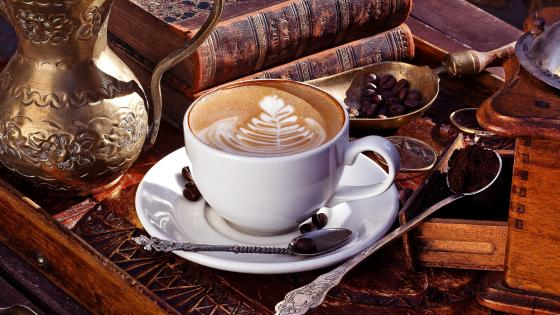 Cappuccino and vintage books wallpaper