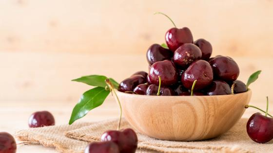Fresh cherry in wood bowl wallpaper