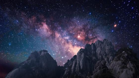 Milky way over the rugged mountains wallpaper