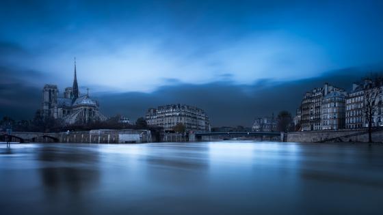 The Notre Dame De Paris and the Seine River wallpaper