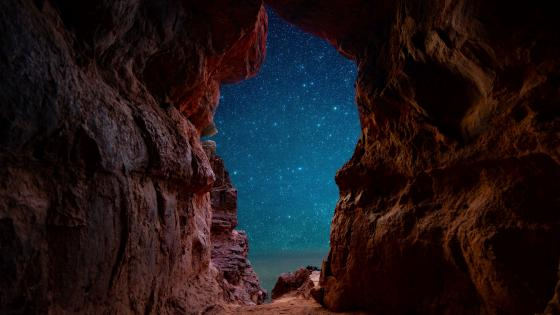Starry sky from a sea cave wallpaper