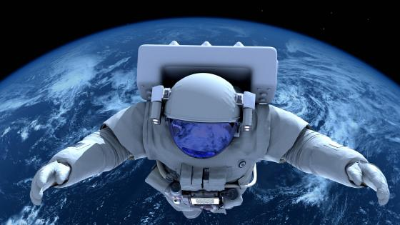 Astronaut looking down at planet earth wallpaper