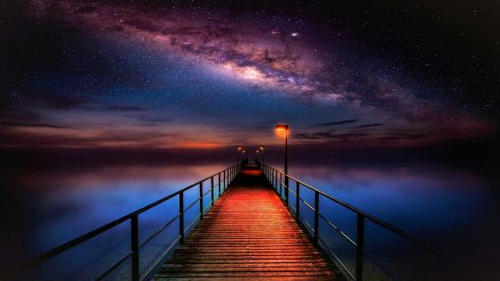 Pier on the sea in  starry night wallpaper
