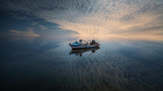 Reflected fishing boat wallpaper