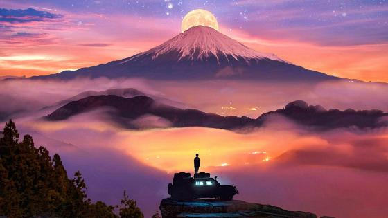 Looking At The Moon Rising Behind The Snowy Mountain wallpaper