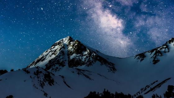 Stars over the snowy mountains wallpaper