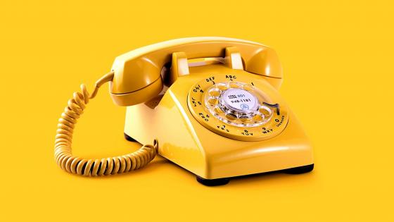 Yelow vintage dial phone wallpaper