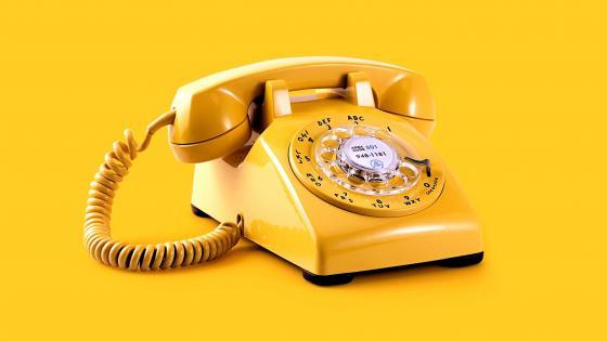 Yelow vintage dial phone wallpaper