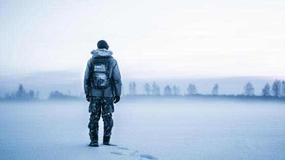 Lone man with backpack wallpaper