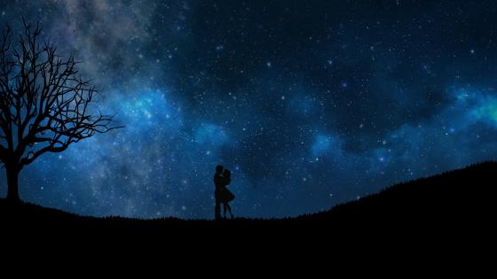 Loving couple under the starry night sky wallpaper
