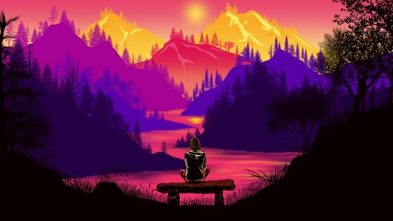 Mountains in the burning sunset from a bench wallpaper