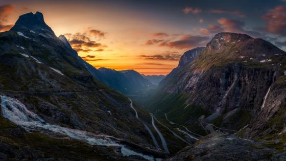 Curvy road in the mountains at sunset wallpaper